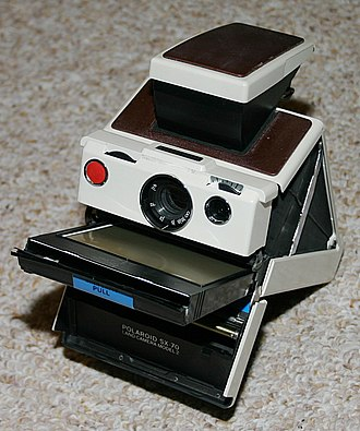 Polaroid SX-70 - SX-70 Model 2 with film cartridge protruding from the front