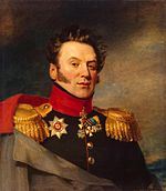 Painting shows a clean-shaven, square-faced man with blowing hair and long sideburns. He wears a dark green military uniform with gold epaulettes and several medals. An overcoat is thrown over his right shoulder.