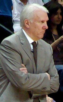 Popovich cross armed - Cropped-2.jpg