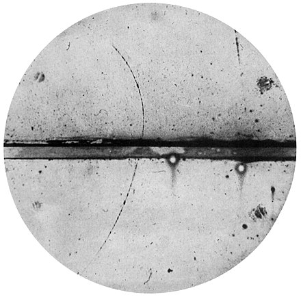Fig. 1: Cloud chamber photograph of the first positron ever observed by C. Anderson. PositronDiscovery.jpg