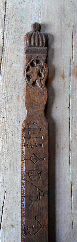 Folk art - Detail of 17th century calendar stick carved with national coat of arms, a common motif in Norwegian folk art.