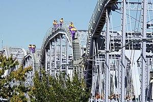 Newport Southbank Bridge - Purple-clad people crossing the Newport Southbank Bridge