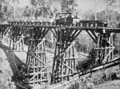 Queensland State Archives 2967 Railway workers crossing Chinamans Creek Bridge 1900.png