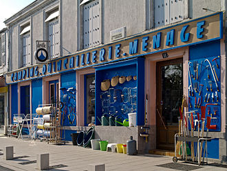 Ironmongery - An ironmonger's shop in France, with iron goods and other consumer goods.