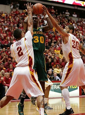 Quincy Miller - Quincy Miller defended by Iowa State's Chris Babb and Royce White
