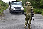 RAAF airman stops a vehicle during Cope North 2018.jpg