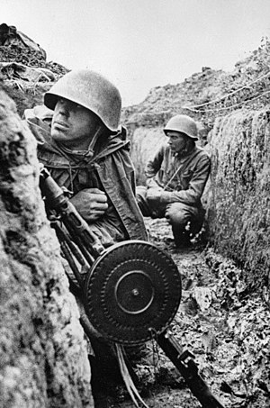 Siege of Leningrad - Two Soviet soldiers, one armed with a DP machine gun, in the trenches of the Leningrad Front on 1 September 1941