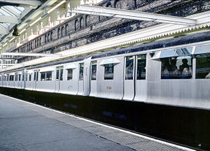 District line - An R Stock train composed of a mixture of unpainted aluminium and (white) painted steel cars