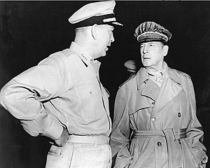 Arthur W. Radford - Radford (left) and Douglas MacArthur confer on Wake Island in 1950. Radford was an admirer of MacArthur and a supporter of his strategies, both before and after the latter's dismissal.