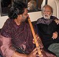 Ravi Shankar teaching Rajan.JPG