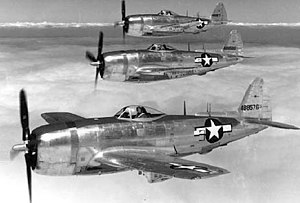 301st Fighter Wing - Three-aircraft formation of Republic P-47N Thunderbolts