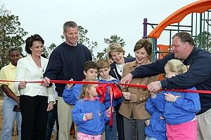 Brett Favre - Brett Favre, third from the left; his wife Deanna, second from the left; and First Lady Laura Bush, third from the right; attend a ribbon cutting ceremony in Kiln, Mississippi, after Hurricane Katrina