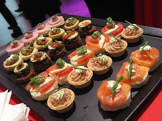 Hors d'oeuvre - A tray of hors d'oeuvres (Canapés) at a cocktail party.