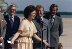 Rosalynn Carter, Jimmy Carter and Vice President Walter Mondale at a ceremony welcoming Mrs. Carter back from her... - NARA - 175133.tif