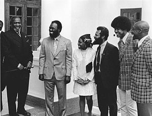 Congress of Racial Equality - CORE President Roy Innis (2nd from left) and then wife Doris Funnye Innis (center) with a delegation from CORE is greeted by Kenyan President Jomo Kenyatta (left).