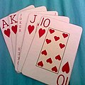 Royal Flush hand with a Joker as Queen in poker game.jpg