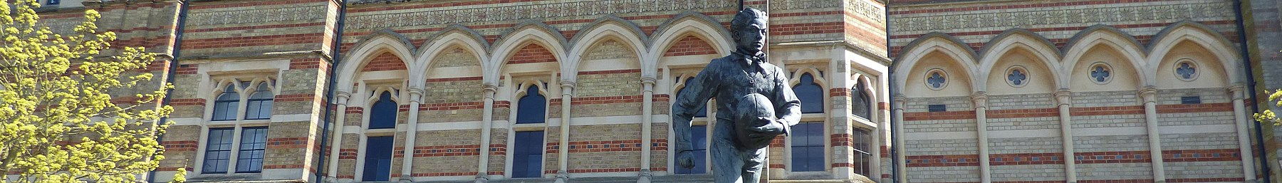 Rugby banner Rugby School and statue of William Webb Ellis.jpg