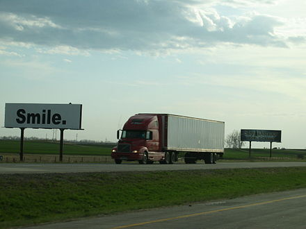 Non-commercial advertisement is used around the world by governments and non-profit organisations to obtain donations, volunteer support or change consumer behavior. North Dakota, May 2004. SMILE billboard.jpg