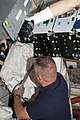 STS-135 Hurley tapes up supply bag.jpg