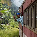 Sabah State Railway Train-Attendant-giving-clearance-signal-01.jpg