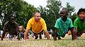 Sailors work with children 120725-N-ZL585-082.jpg