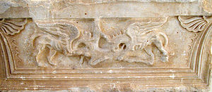 Capital of the front of the west facade of the Ptolemy II Propylaeum: Griffons devouring a doe (site plan number 20)