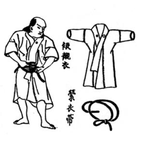 Shitagi - Antique Japanese wood block print of a samurai putting on a shitagi.