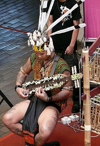 Demographics of Sarawak - A young Sarawakian playing the sapeh
