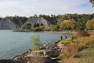 The Scarborough Bluffs is an escarpment, formed during the Last Glacial Period as part of the Glacial Lake Iroquois shoreline, which runs along the eastern portion of the Toronto waterfront. Scarborough Bluffs - Laslovarga (56).jpg