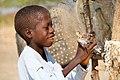 Shepherd and his bird in Zimbabwe.jpg