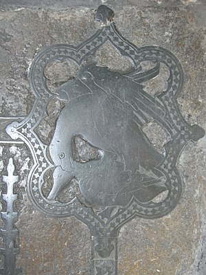 Peter Courtenay (died 1405) - Heraldic device showing within a barbed quatrefoil a hawk mantling over its prey of a duck. From the monumental brass of Sir Peter Courtenay (d.1405),  Exeter Cathedral, south aisle