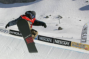Snowboarder in the halfpipe.