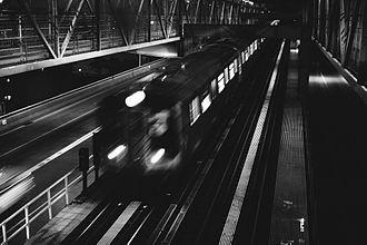 Williamsburg Bridge - The J train on the bridge's tracks, seen before sunrise