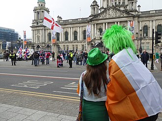 People carrying the Irish flag, overlooking those with the unionist Ulster Banner St Patricks Day, Belfast, March 2015 (39).JPG