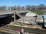 Stairs from commuter rail platform at JFK UMass station to Columbia Road, April 2016.JPG