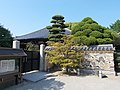 Stone wall and Main temple of Myoraku-ji.jpg