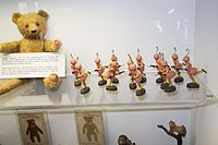 Strange antique toy aliens with skirts and WWI rifles (26947552765).jpg