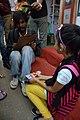 Street Portrait Artist with Girl - 40th International Kolkata Book Fair - Milan Mela Complex - Kolkata 2016-02-02 0424.JPG