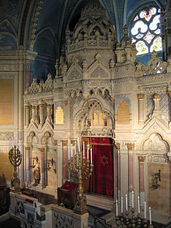 Torah ark A receptacle which contains a synagogues Torah scrolls