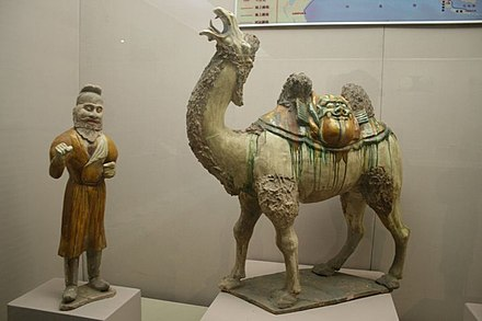 Tang dynasty tomb figure, sancai glazes, of a Bactrian camel and its foreign driver Tang Dynasty sancai pottery camel and man.JPG