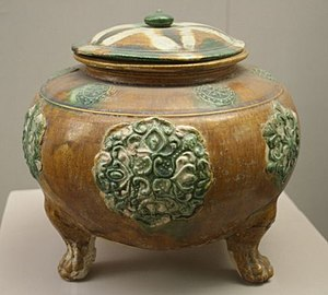 Sancai - Tang footed jar with relief decoration