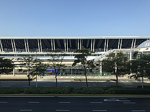 Terminal 1 of Shanghai Pudong International Airport from Pudong International Airport Station (Shanghai Maglev).jpg
