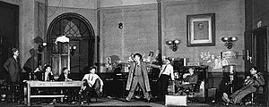 Joseph Calleia - Calleia (far right) as the lazy, banjo-playing reporter Kruger in the original Broadway production of  The Front Page (1928)