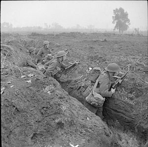131st Infantry Brigade (United Kingdom) - Infantrymen of the 1/5th Battalion, Queen's Royal Regiment occupy a captured German trench at Laar during the drive on Hertogenbosch, Holland, 24 October 1944.