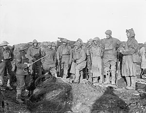 York and Lancaster Regiment - Men of the York and Lancaster Regiment receiving instructions in the trenches before starting out on a patrol near Roclincourt, France, 12 January 1918. Note their camouflaged outfits.