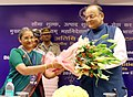 The Chairperson, CBEC, Ms. J.M. Shanti Sundharam presenting bouquet to the Union Minister for Finance, Corporate Affairs and Defence, Shri Arun Jaitley.jpg