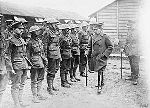 176th (2/1st Staffordshire) Brigade - King George V inspecting the remnants of the 2/6th Battalion, North Staffordshire Regiment; Gauchin, 30 March 1918.