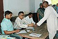 The Polling Officer administering indelible ink at the finger of a voter at a polling station of Suchi in Soalan, Rae Bareli, during the 2nd Phase of General Election-2009 on April 23, 2009.jpg