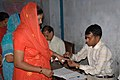 The Polling officer administering indelible ink at the finger of a female voter at a polling booth at the DCM Jain Sec. School, Ferozpur Cantt., Punjab, during the 4th phase of General Election-2009, on May 07, 2009.jpg