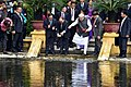 The Prime Minister, Shri Narendra Modi and the Prime Minister of the Socialist Republic of Vietnam, Mr. Nguyen Xuan Phuc feed fish in Uncle Ho's pond, in the Presidential Place Compound, in Hanoi, Vietnam.jpg